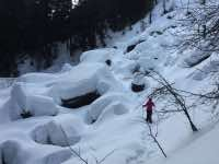 Finding your way through a snow covered rock slide.